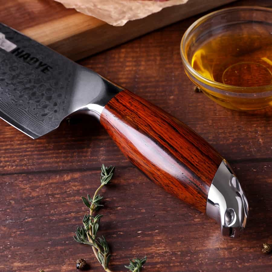 A knife sitting on top of a wooden cutting board