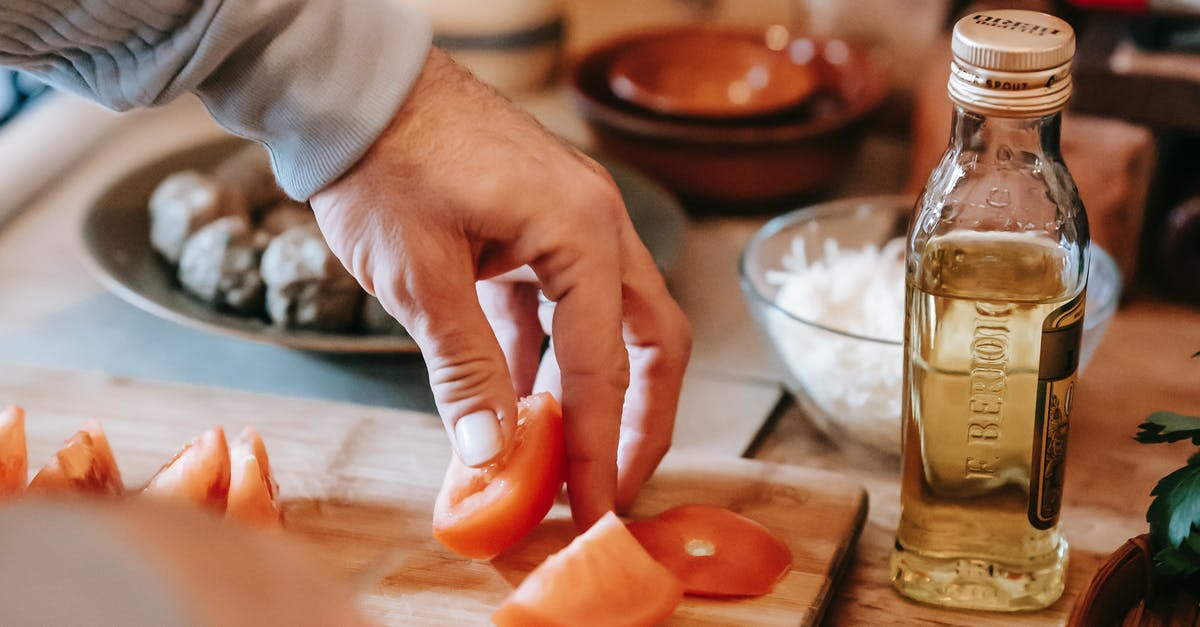 A close up of a person cutting a piece of food on a table